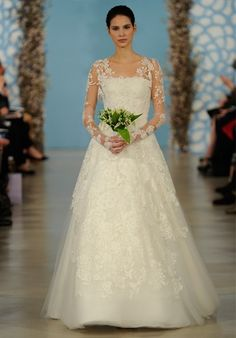Oscar de la Renta  Bridal 2014 Look 2   DRESS DETAILS  Silhouette: A-Line Neckline: Square Waist: Natural Gown Length: Floor Sleeve Length: Long Train Style: Attached Train Length: Sweep Sleeve Style: Detachable, Fitted Fabric: lace Tulle Embellishments: Beading, Embroidery, Lace Color: white Size: 0 - 16