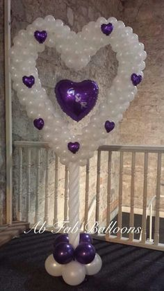 Balloon heart sculpture in white and purple.
