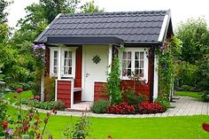 The countryside in Sweden littered with red and white summer cottages