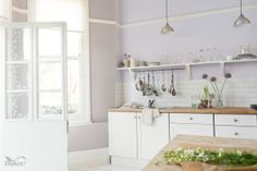 A light and airy kitchen in pastel shades, with Dulux Imperial Mauve 4 (wall with shelving), Dulux Potter's Clay 2 (window wall) and Clouded Pearl 3 (woodwork trim)