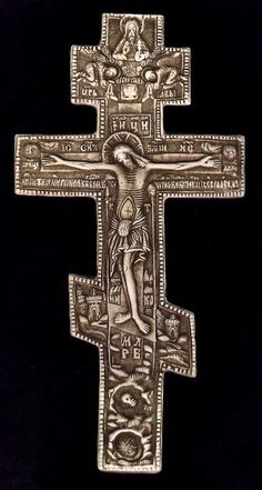 Russian Triple Cross.  This precious early 19th century Orthodox cross tells the story of the Crucifixion with panels of the Blessed Virgin, St. Mary Magdalen, St. John and St. Longinus the Soldier on either side.