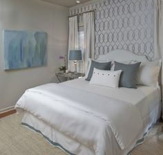 Stacy Naquin - beautiful blue bedroom with white upholstered headboard and tray tables