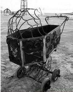 from the cradle to the grave, seriously warped and spooky pram for your own rosemarys baby, upside down crucifix optional , last used by lily munster...halloween funny photography