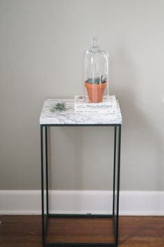 table made from ikea washing bin and paper marble