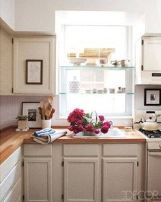 """Counters are IKEA butcher block, the cabinets from Home Depot are painted in Ralph Lauren Paint's """"Peony."""""""