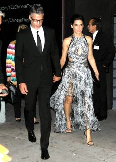 Sandra Bullock looked stunning next to her handsome boyfriend, Bryan Randall, at the premiere of her new film, Our Brand Is Crisis. See the pics at Usmagazine.com!