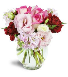 Joyful, joyful! That's how she'll feel after receiving this charming  gift of soft pinks and deep reds. It's a modern combination for a modern  woman!Pink roses, lisianthus, and frilly stock are accented by lush red carnations for a sweet and spicy twist!