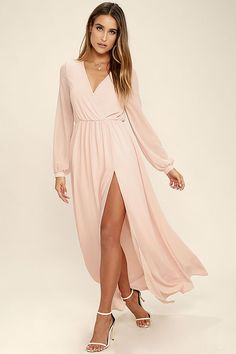 Take a moment to marvel at the sheer beauty of the Wondrous Water Lilies Blush Pink Maxi Dress! Blush pink chiffon shapes a surplice bodice framed by sheer long sleeves. A billowing maxi skirt with front slit falls below the elasticized waist for a stunning finish.