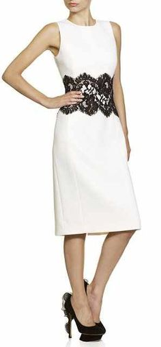 From the Michael Kors Collection, the white sheath dress with lace trim retailed for $1533.