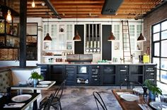 The Grounds: Loving the black & white combination kitchen, rolling library ladder and copper pendents. Oh, and those containers under the bench!