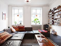 http://myscandinavianhome.blogspot.se/2013/05/a-swedish-apartment-with-bold-tribal.html