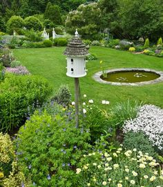 Classic Connecticut Garden | Traditional Home Love bird house and choices of plants.  Gate in back, boxwood pyramids flanking path