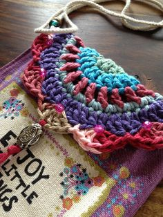 Ravelry: Little Up-cycled Bag. A badge holder turned into a sweet little purse using kitchen cotton yarn, some beads, a crochet hook, and a couple hours.