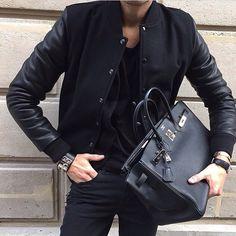 Black Birkin bag and Collier de chien bracelet by Hermès