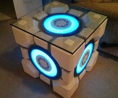 Give your living room a quirky touch by building your very own weighted Portal s. - Give your living room a quirky touch by building your very own weighted Portal storage cube table f - Companion Cube, Cube Coffee Table, Cube Table, Nerd Room, Gamer Room, Nerd Cave, Cube Storage, Diy Storage, Storage Ideas