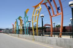 Arts and Venue Denver | Public Art | Denver Public Art Collection | Seven Sisters  David Griggs  Painted Fabricated Steel  Elitch Gardens/Pepsi Center Light Rail Station