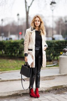 Mixed but matched. Cream fur coat. Red suede boots. Patent leather pants. Street style Paris