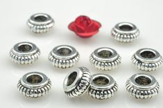 200 pcs of Antique Silver plated jewelry ,carve wheel Spacer Connector,metal Spacer beads in 7mm wide X 3mm Thick