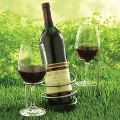 Steady Sticks Outdoor Wine Bottle and Glass Holders: Weather resistant stainless steel holders are sturdy and simple to use. Just push one (or several) into the grass or sand for spill-free wining and dining. 3-pc set includes bottle stick and 2 stemware sticks.