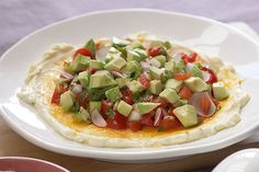 Pico de gallo, so delicious on its own, gets dressed up with cream cheese and chopped avocados in this party-perfect layered dip.