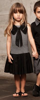 Here's another over-sized bow look:  Sierra Julian Tween Girls Fifth Avenue Black and White Cabella Bow Dress