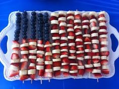 America Flag Fruit Skewers. This is very easy to put together. All you need are wooden skewers, blueberries, strawberries, and bananas. Yum!