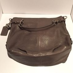 Olive Coach Hamdbag New, authentic Olive leather Coach handbag. Comes with detachable shoulder strap. Interior of handbag is in a dark pastel blue color. Contains three pouches, one of which has a zipper. Comes with Coach dust bag. No trades. Low offers will be declined. Thank you! Coach Bags Shoulder Bags