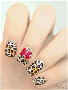 Leopard print on gradient nails with a red bow