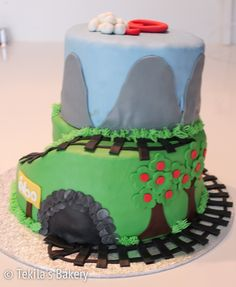 Railway cake with apple trees, cave, mountains, sky, clouds