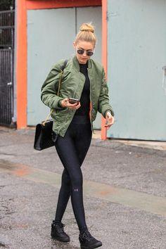 Gigi Hadid wearing Vianel Cream Lizard Iphone Case, Saint Laurent Monogram Matelasse Bag, Under Armour Leggings and Alpha Industries Ma-1 Flight Jacket in Sage