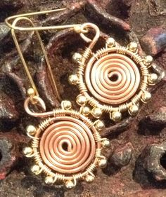 A personal favourite from my Etsy shop https://www.etsy.com/uk/listing/256109663/copper-and-gold-sun-disc-earrings-two