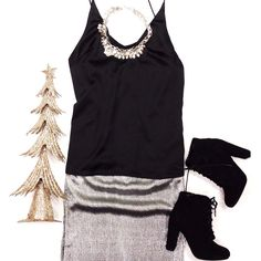 It's almost time to start fussing about New Years Eve! Come get an outfit that everyone will be talking about. ❤️ #xoxoAL4You #NewYearsEve #ootn #booties #outfit #shoplocal #apricotlane Sassy Satin Tank Top $36 Shimmer & Shine Skirt (Silver) $46 Comment or click with the link below. http://form.jotform.us/form/52044697810154
