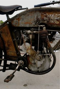Pedal motor bike. Love the patina of gas and oil. I bet it smells amazing.