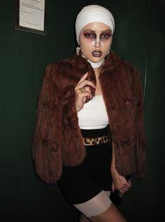 plastic surgery junkie.  halloween 2012?