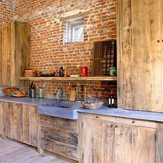 This is.a lot of brick and wood, its almost too rough cut but I think I really like it. Brick, Stone, Wood and Concrete: 15 Beautiful, Rustic Kitchens Wooden Kitchen, New Kitchen, Kitchen Ideas, Concrete Kitchen, Kitchen Layout, Concrete Sink, Kitchen Sink, Kitchen Interior, Concrete Bricks