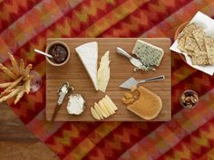 Learn how to set up a cheese platter with easy step-by-step instructions and pictures from Food Network.Make a bamboo or wooden cheese board really pop by placing it on a colorful tablecloth. Drunken Goat Cheese, Clotted Cream Recipes, Gouda Recipe, Cheese Day, Easy Cheese, Wine Cheese, Food Network Recipes, Cooking Recipes, Cooking Food