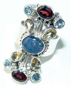 Beautiful item with Fire Opal, Mixed Faceted Stones Gemstone(s) set in pure 925 sterling silver.