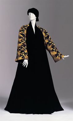 Black silk velvet evening coat by Clade Saint-Cyr,  tapestry sleeves designed by Jean Picart Le Doux.  French, ca. 1950.