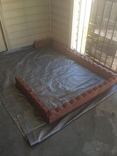 Beginning puppy potty porch. Bleach porch, lay down tarp, surround with decorative stone.