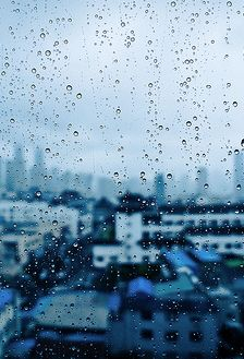 Do you not see beauty in the rain? The way the drops move slowly down the glass...