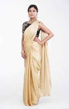 Golden Shimmer Saree with Velvet Blouse by Preeti SInghal  This Golden Shimmer Satin Saree comes with a stunning Velvet Hand Embroidered Blouse with embroidery and mukaish work.
