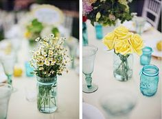 Blue mason jars and yellow flowers for our centerpieces