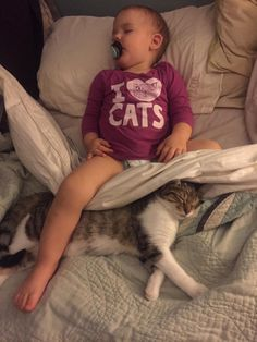 Just a baby and her kitty taking a snooze. http://ift.tt/2id2Xk0
