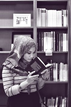 Hijab and books in the background, love it.