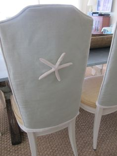 Cute starfish on the back of slipcovered chairs.