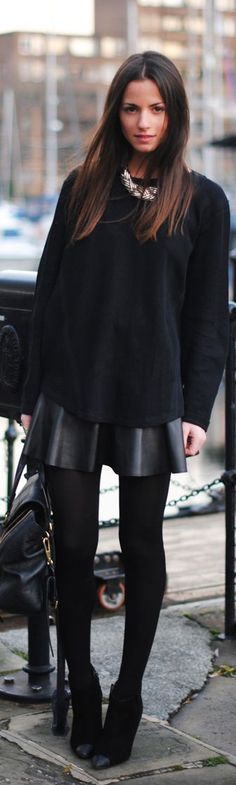 oversized sweater, leather circle skirt accented with a chunky bib necklace black on black on black.. CHECK PLEASE