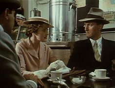 Look at the rakish slant of that hat.  Agatha Christie's Poirot: Capt. Hastings, Miss Lemon, and Poirot.