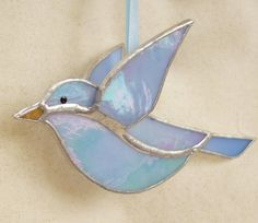Small 3D stained glass bluebird is made of iridescent glass