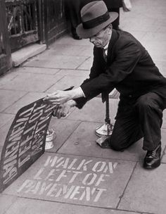 Walk on the left signs are painted on the pavement at 400 points in Southgate in order to cut down pavement collisions in the black out. (October 1942)