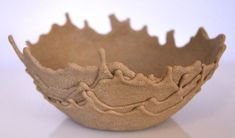 Sand Bowls -  sand mixed with glue and dripped over a bowl until it hardens. Would be neat way to display favorite shells brought back from beach vac!